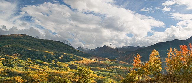 [© Capitol Retreat Panorama by Judy Hill is described with Capitol Peak, Colorado, Daly, Elk Range, Mt. Daly, Rockys, White River National Forest, Mountain, Mountains, 2005, Autumn, Fall, Rocky Mountains, Blue, Air, Alpine, Aspens, Blue sky, Brush, Clouds, Evergreen, Foliage, Leaf, Leaves, Pine, Pines, Green, golden, Beige, Gray, Neutrals, Warm, Yellows, White, Rocky, Tree, Trees, Woods, Fine Art, Stock, Color, Horizontal, Panorama hit 14438 rate ]