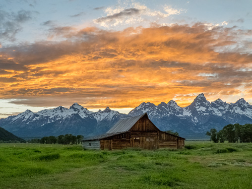 [© Mormon Row Barn and Tetons by Amory B. Lovins is described with Fine Art, Stock, Grand Teton National Park, Sunset, Horizontal, Barn, Grand Tetons, Mountains, Mormon Row, Clouds, orange, grey, green, blue, snow, Rocky Mountains, retro hit 3774 rate ]